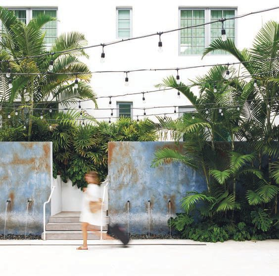 A guest walks by the property's outdoor atrium. THE BETSY SOUTH BEACH PHOTO BY READ MCKENDREE